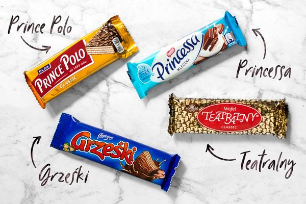 Polish Chocolate Wafers: Prince Polo, Princessa, Grześki and Teatralny. Top view/flat lay on a white marble surface.