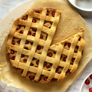 Flat lay Gooseberry Pie with Lattice on white background