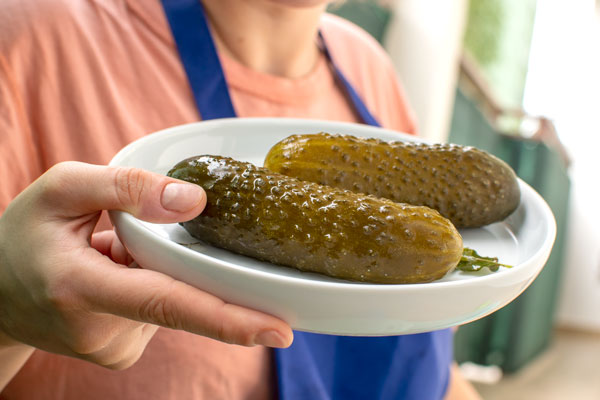 Polish Dill Pickles on a white plate, well fermented.