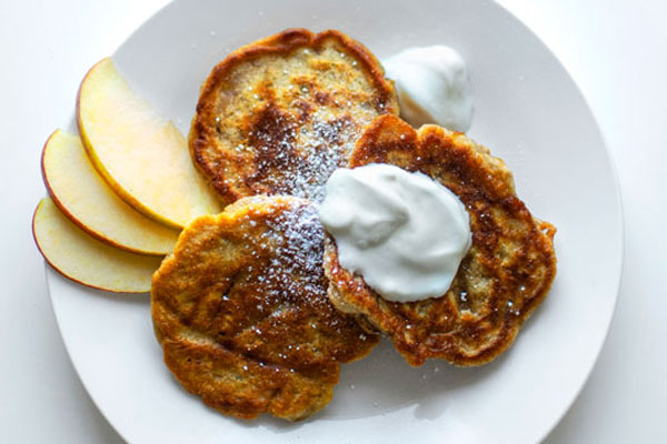 Apple Racuchy (Polish Apple Pancakes), served with fresh apple slices, fresh cream and sprinkled with sugar