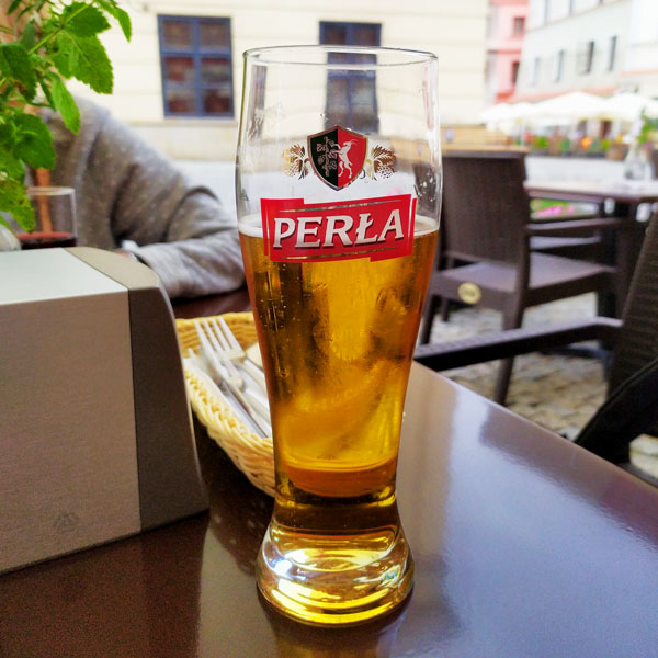 A glass of Perła - Polish beer from Lubelskie region
