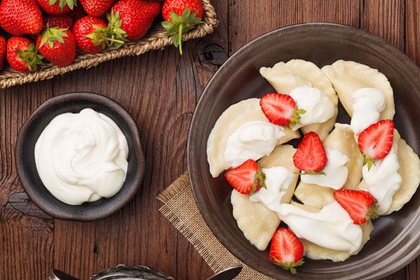 Pierogi Served with sweetened cream and strawberries
