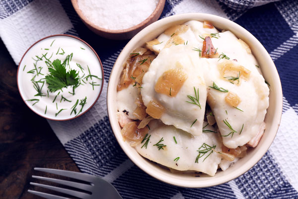 Pierogi served with Sour Cream Sauce for dipping