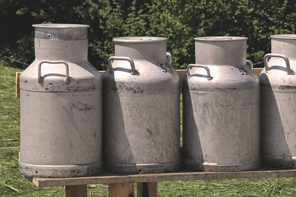 Milk cans stored outdoors